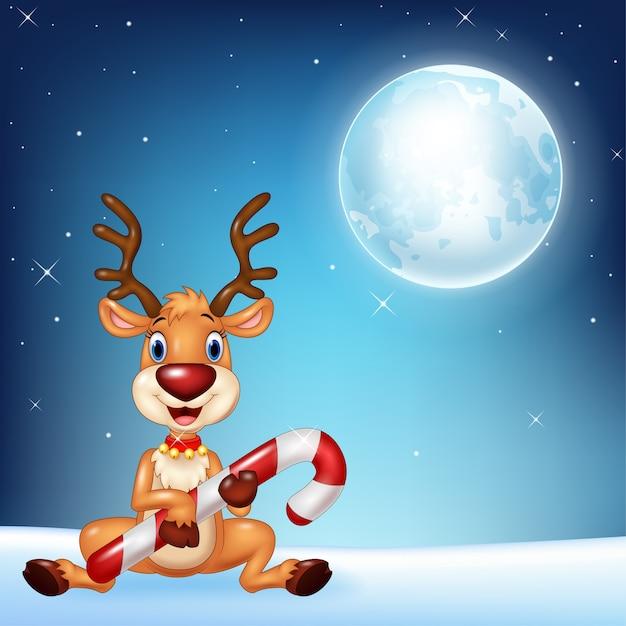 Иллюстрация ребенка оленей, проведение рождественские конфеты Premium векторы