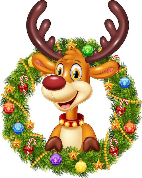 クリスマスリースを保持する漫画の面白い鹿 Premiumベクター