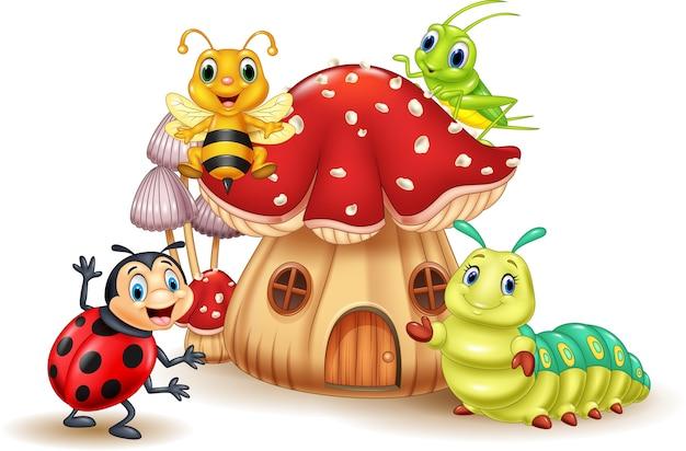 Мультяшные смешные насекомые с грибным домом Premium векторы