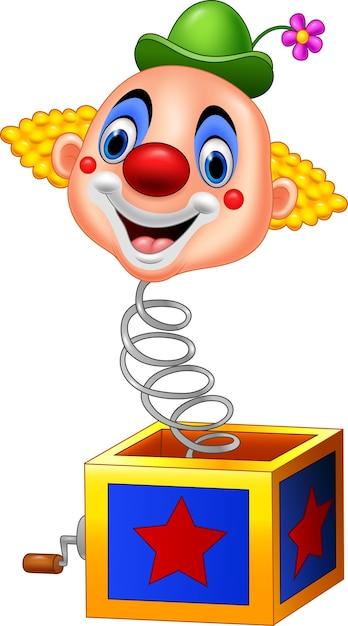 Мультяшная клоунская голова выходит из коробки Premium векторы