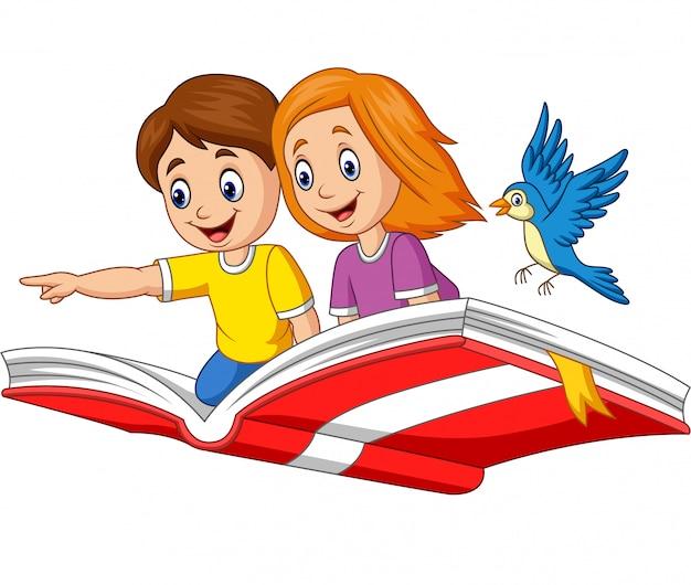 男の子と女の子が本を飛んで Premiumベクター