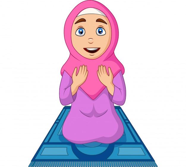 祈りの敷物を祈る漫画イスラム教徒の女性 Premiumベクター