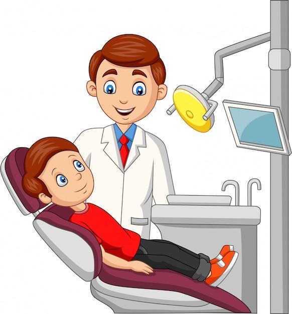Мультфильм маленький мальчик в офисе стоматолога Premium векторы