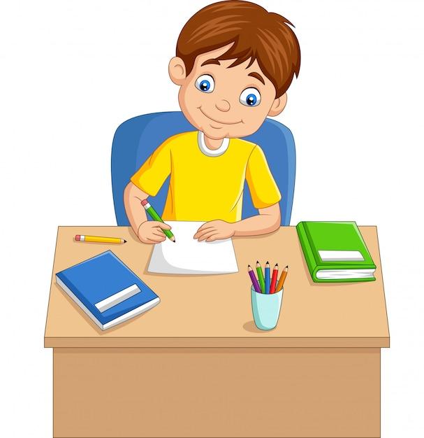 漫画の少年がテーブルの上で勉強 Premiumベクター