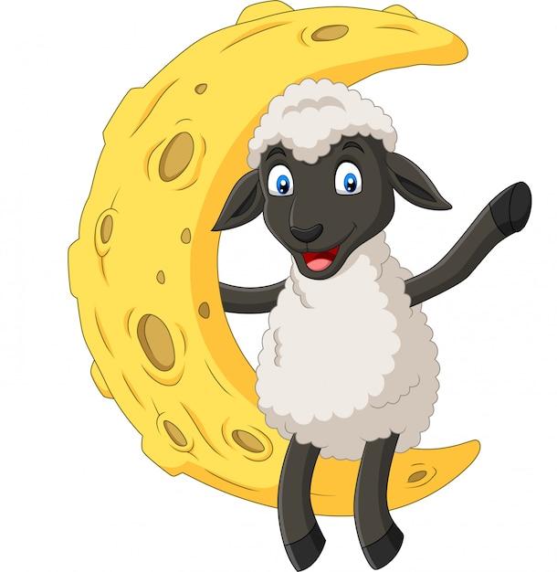 月の上に座って漫画かわいい羊 Premiumベクター