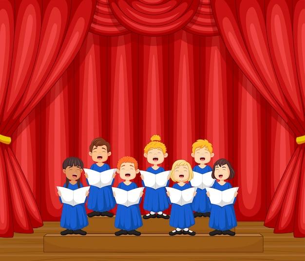 Хор детей поет песню на сцене Premium векторы