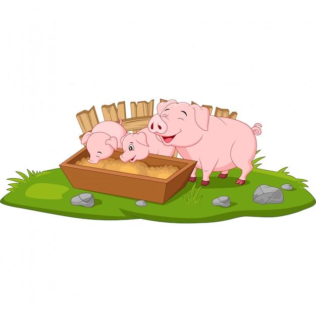 かわいい漫画の母豚と子豚 Premiumベクター