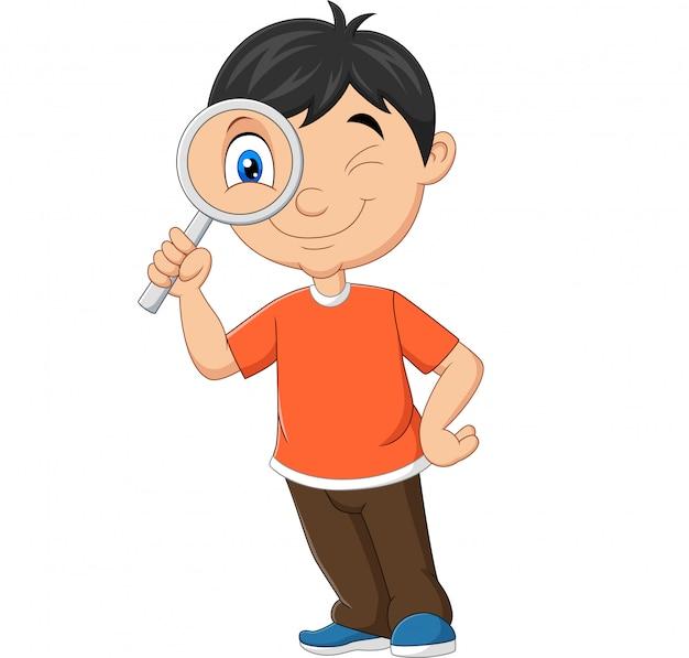 虫眼鏡を使用して小さな男の子 Premiumベクター