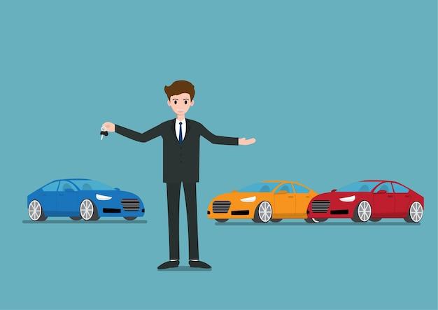 セールスマンが立って、新しい車のキーを販売している Premiumベクター