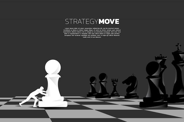 チェス盤にビジネスプッシュポーンチェス作品。 Premiumベクター