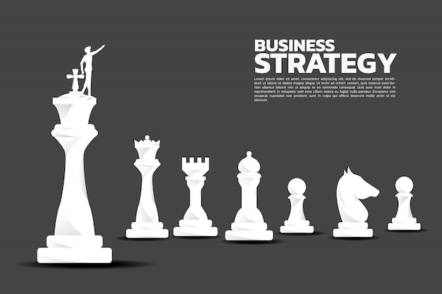 ビジネスマンのシルエットはチェスの駒と前方を向く。 Premiumベクター