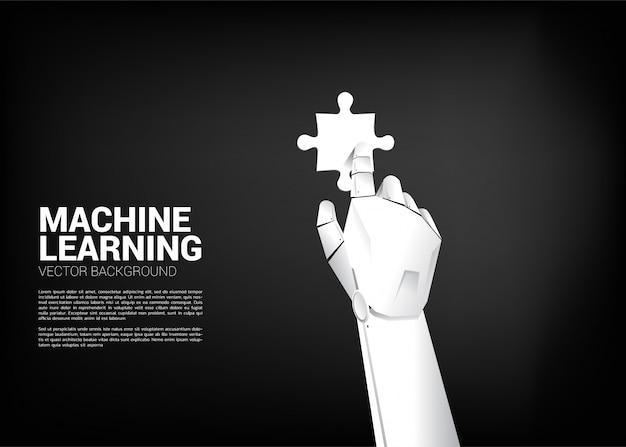 ロボットの手がジグソーパズルに触れます。機械学習と人工知能のためのビジネスコンセプト Premiumベクター