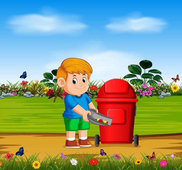 少年は庭の赤いビンに危険物を投げる Premiumベクター