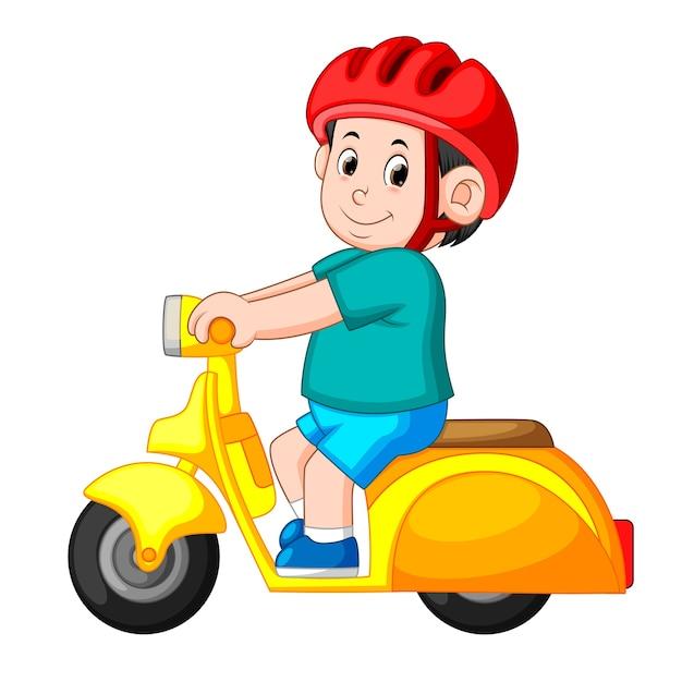 男は黄色のベスパ・オートバイに乗って、赤いヘルメットを使います Premiumベクター