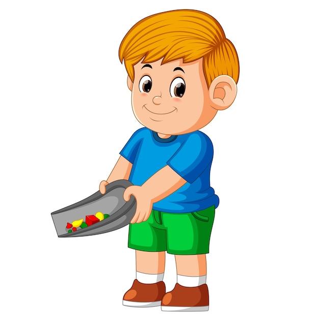 青い布を使用していて、日陰のごみをきれいにしている少年 Premiumベクター