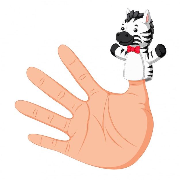 親指のゼブラの指の人形を身に着けている手 Premiumベクター