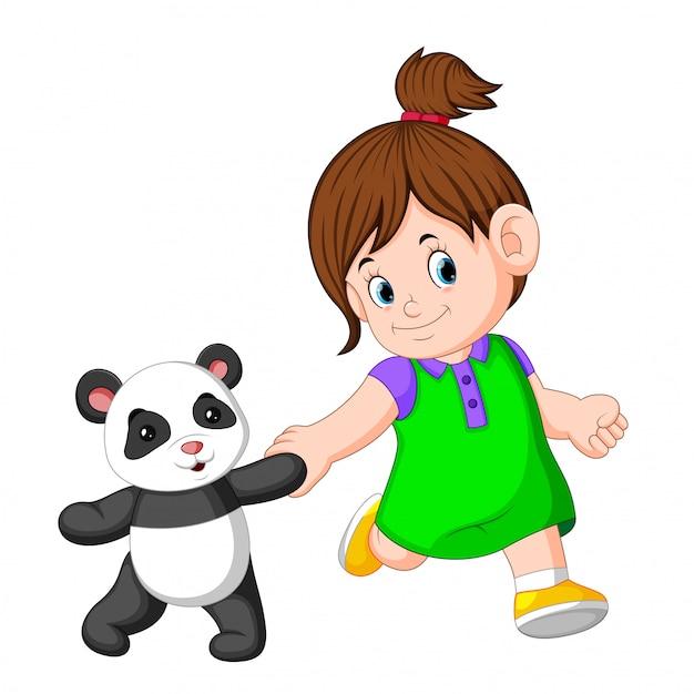 女の子はパンダの人形で遊ぶのが好きです Premiumベクター