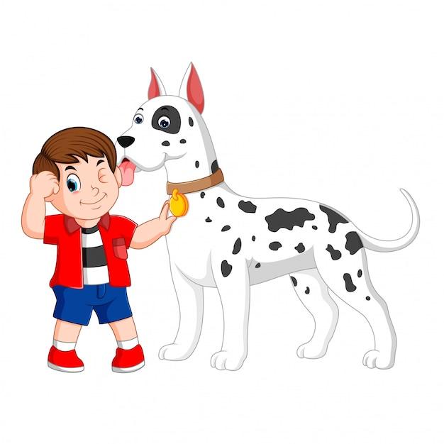 赤いシャツの少年は彼の大きな白いダルメシアン犬を抱いています。 Premiumベクター