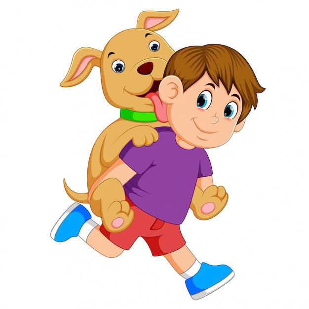 紫色の布と赤いズボンを持つ少年は彼のかわいい犬を驚かせてピックです。 Premiumベクター