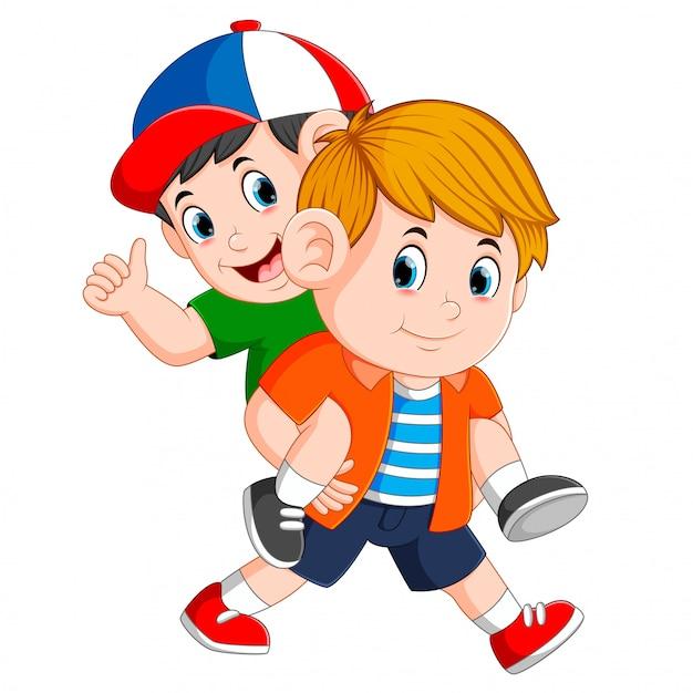強い少年は彼の背中に彼の友人を運んでいます Premiumベクター