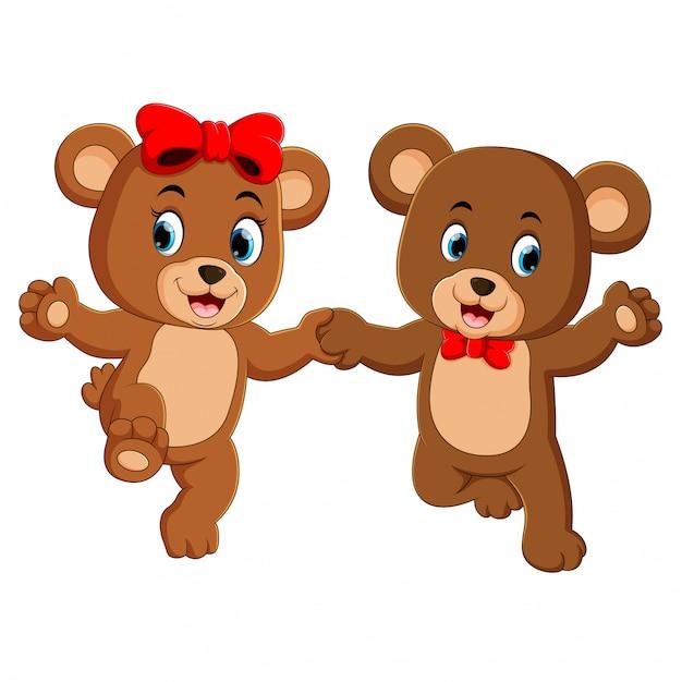Две милые медведи держат каждую руку со счастливыми лицами Premium векторы