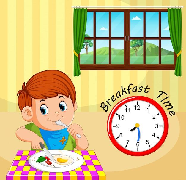 男の子の朝食時間 Premiumベクター