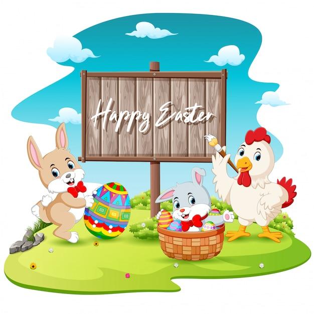 幸せなウサギと酉塗装卵空白の木製看板の背景 Premiumベクター