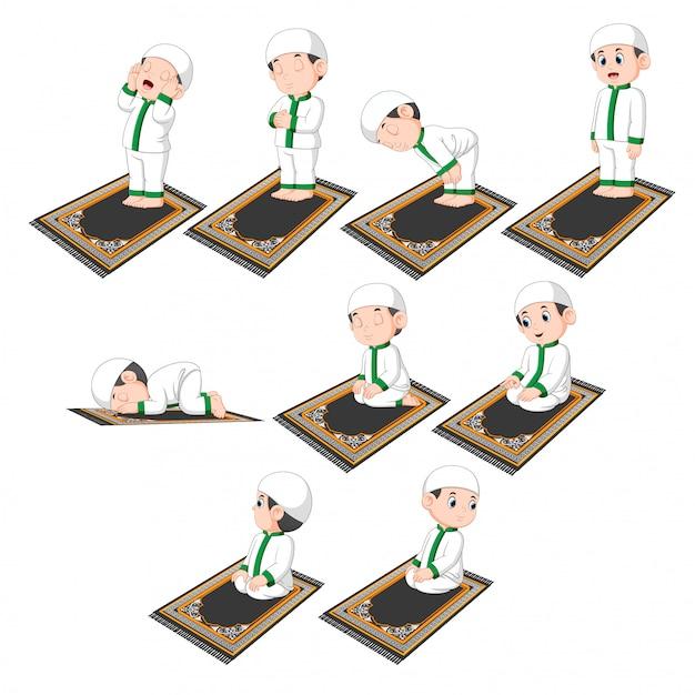 Группа процедур молитвы, выполняемых милым мальчиком Premium векторы