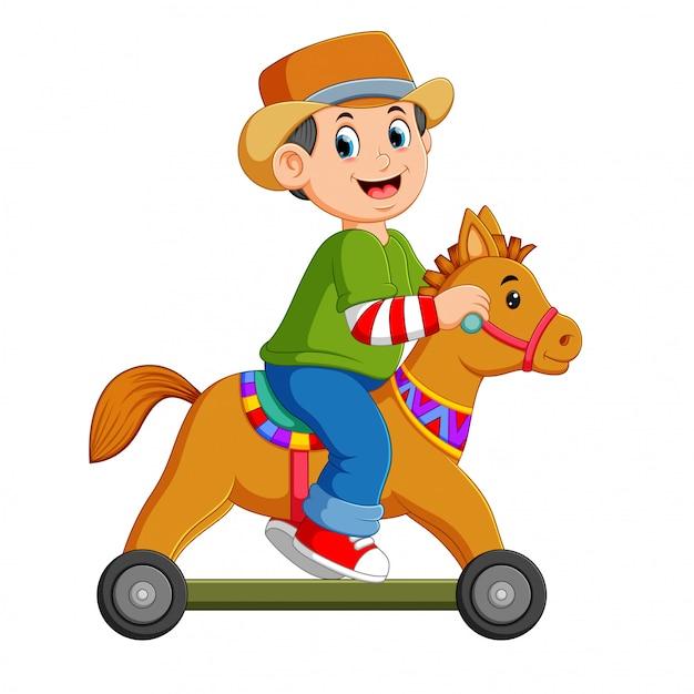 少年は車輪で馬のおもちゃで遊んでいます。 Premiumベクター