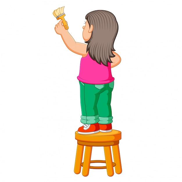 少女は椅子に座っていると絵のためのブラシペイントを保持 Premiumベクター