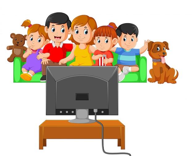 Дети с родителями вместе смотрят телевизор Premium векторы