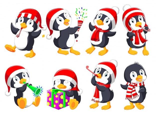 Коллекция милых рождественских пингвинов Premium векторы