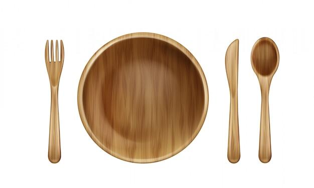 Деревянная тарелка, вилка, ложка и нож вид сверху. Бесплатные векторы