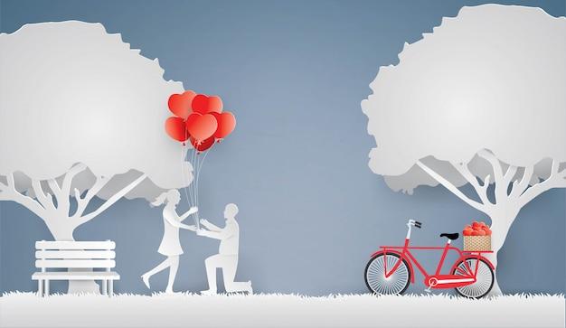 恋人は春にハート型の風船として贈り物をする Premiumベクター