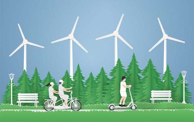 Молодой мальчик ехать электрический самокат, пара путешествуя на велосипеде в парке на зеленой траве в предпосылке парка. Premium векторы