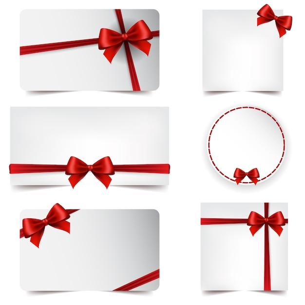 赤いリボンのクリスマス&新年の挨拶カード Premiumベクター