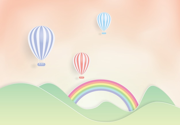 山の上を飛んでいるカラフルな熱気球、ペーパーカット Premiumベクター