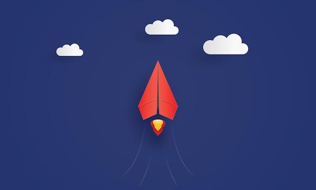 Самолет лидера красной бумаги, летящий в небе Premium векторы