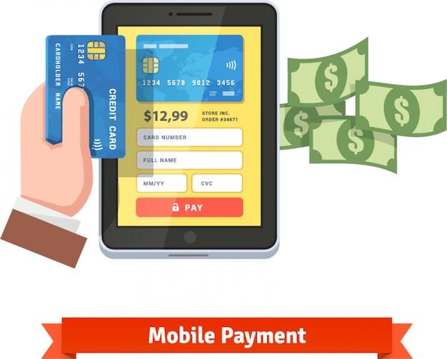 Человеческая рука, держащая кредитную карту над планшетом Бесплатные векторы