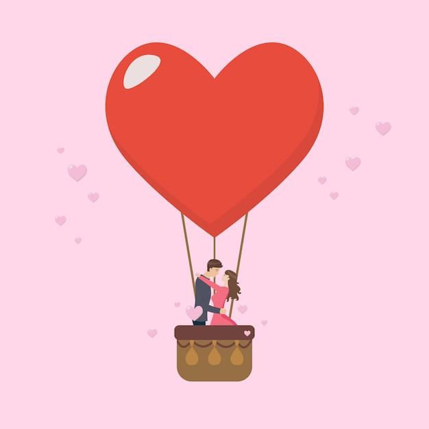 愛情のあるカップルが大きなハートのバルーンにキスします。 Premiumベクター