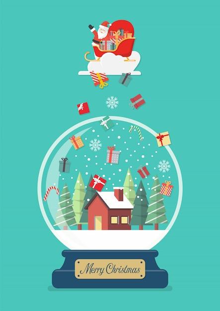 С рождеством стеклянный шар с дедом морозом с подарочными коробками, падающими в зимний дом Premium векторы
