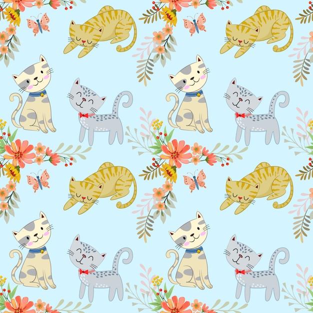 かわいい漫画の猫と花のシームレスパターン。 Premiumベクター