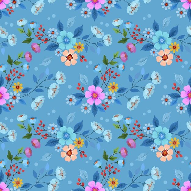Красочная нарисованная рука цветет безшовный дизайн вектора картины для обоев ткани ткани. Premium векторы