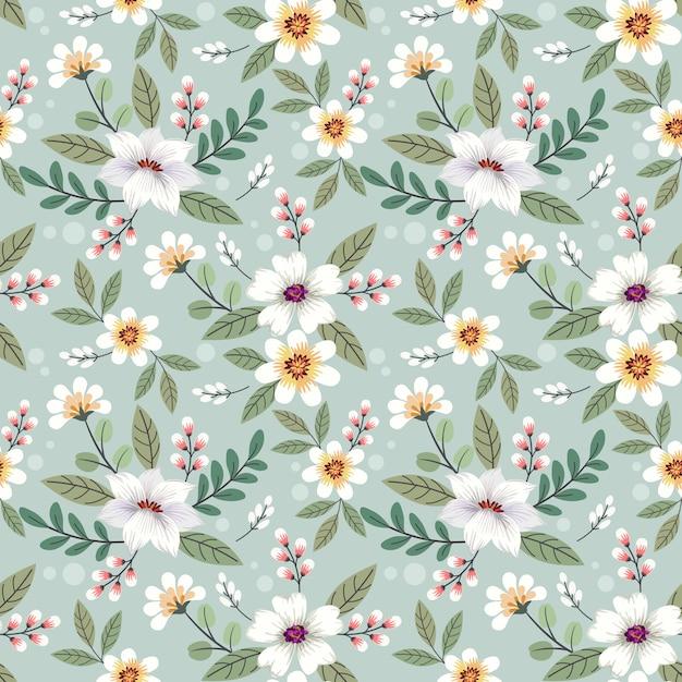 カラフルな手描きの花のシームレスなパターンデザイン。 Premiumベクター