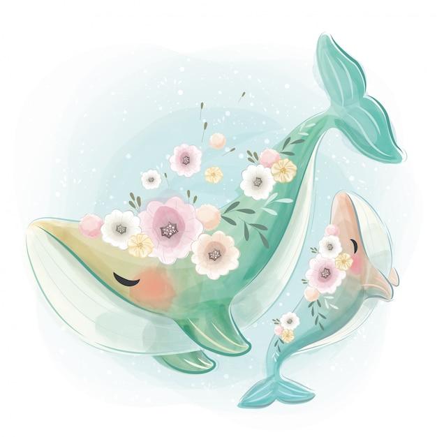 一緒に踊るかわいいと赤ちゃんのクジラ Premiumベクター