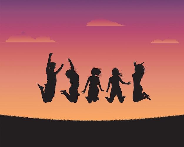 夕日を背景のシルエット幸せな若者たち Premiumベクター
