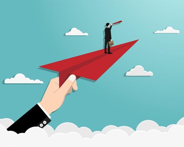 Человек на бумажном самолете в небе Premium векторы