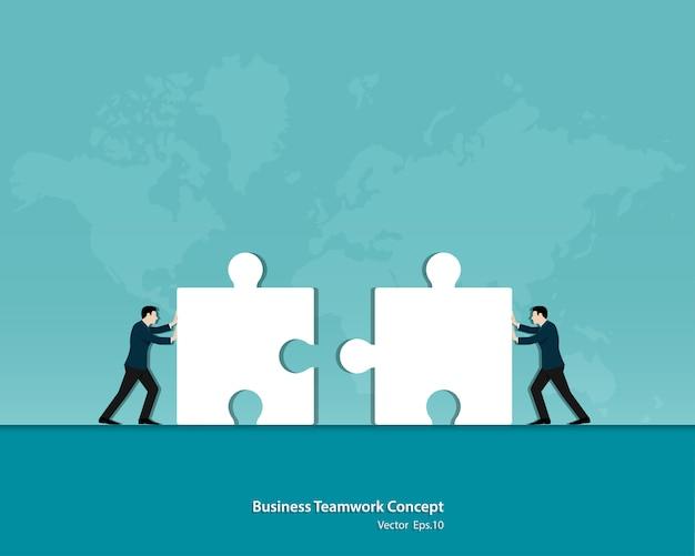 Два бизнесмена, собирать пазлы вместе Premium векторы