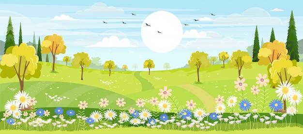 青い空と丘の上の緑の牧草地と春の村のパノラマビュー Premiumベクター