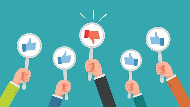 多くの手が親指を上げますが、意見が一致しないか嫌いな意見が出ます Premiumベクター